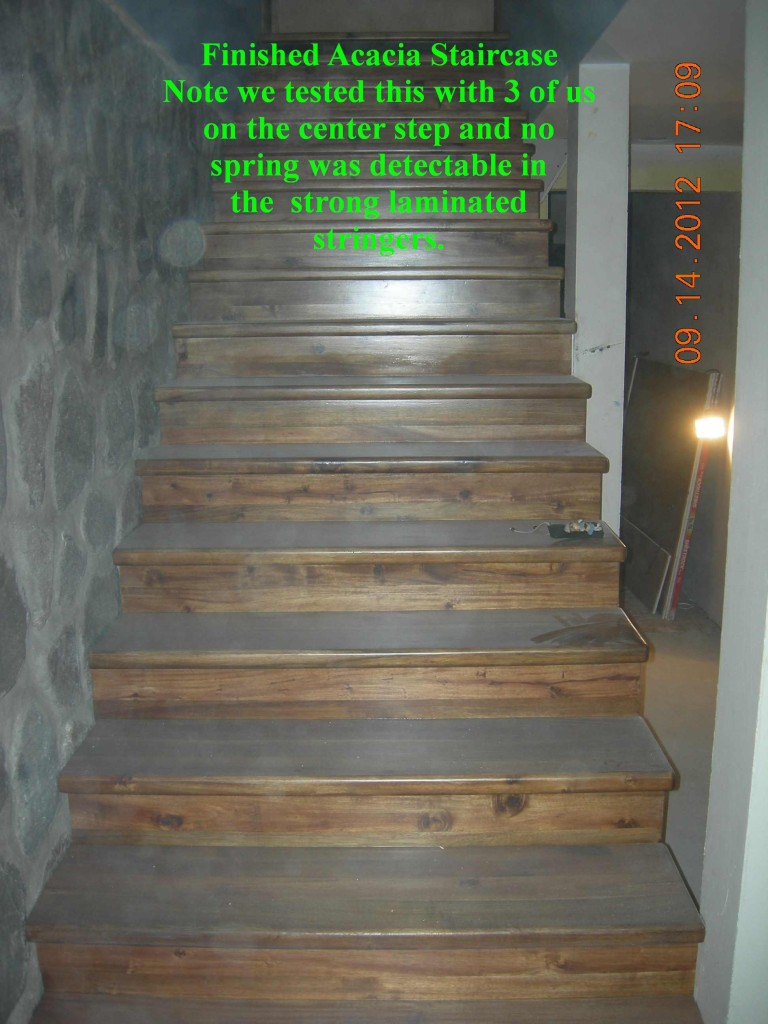 Finished Acacia staircase with 5.2 meter (17 ft) long stringers (support beams) Montaña Paraiso, Escazu, Costa Rica
