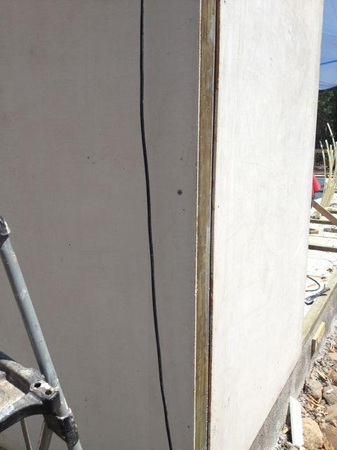 Wood stud glued and screwed into corners