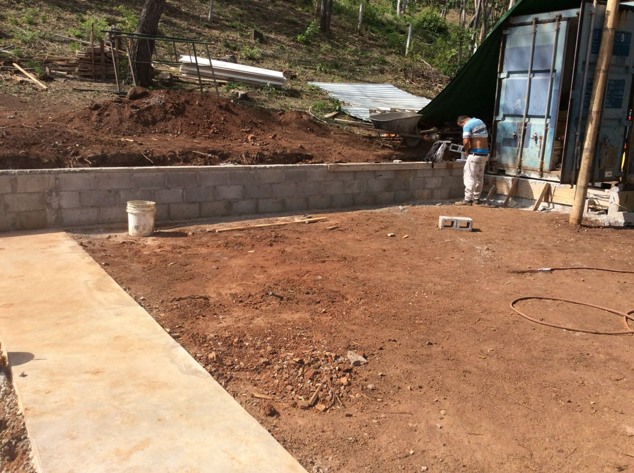 Retaining wall to container