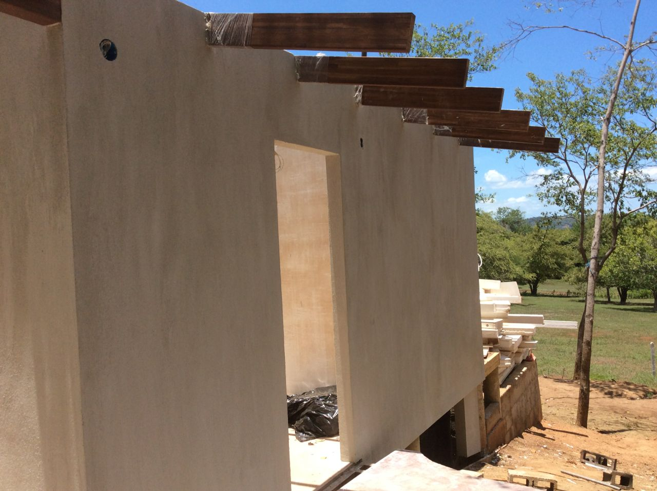 First coat stucco west wall