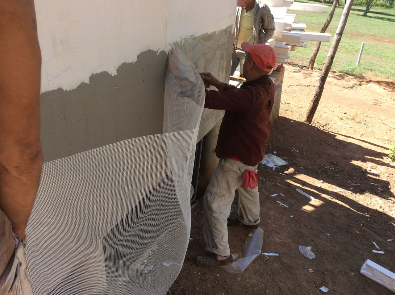 First mesh laid into stucco